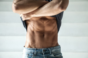 closeup photo of man in jeans with perfect abdominal muscles